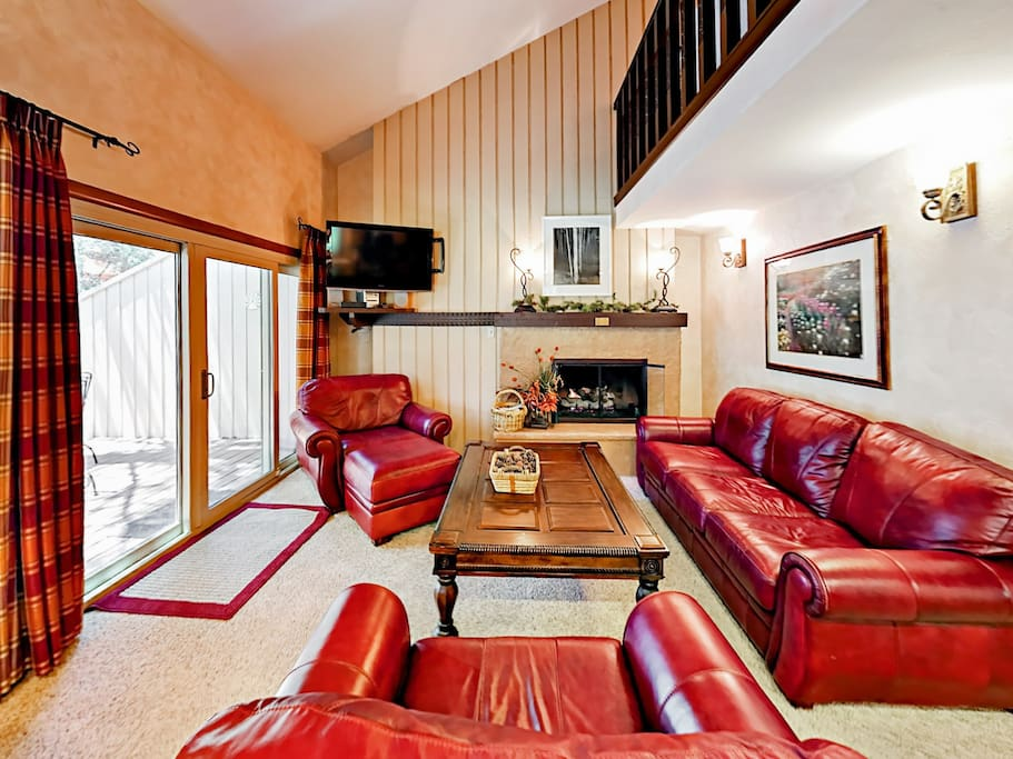 A gas fireplace warms up this cozy living room.