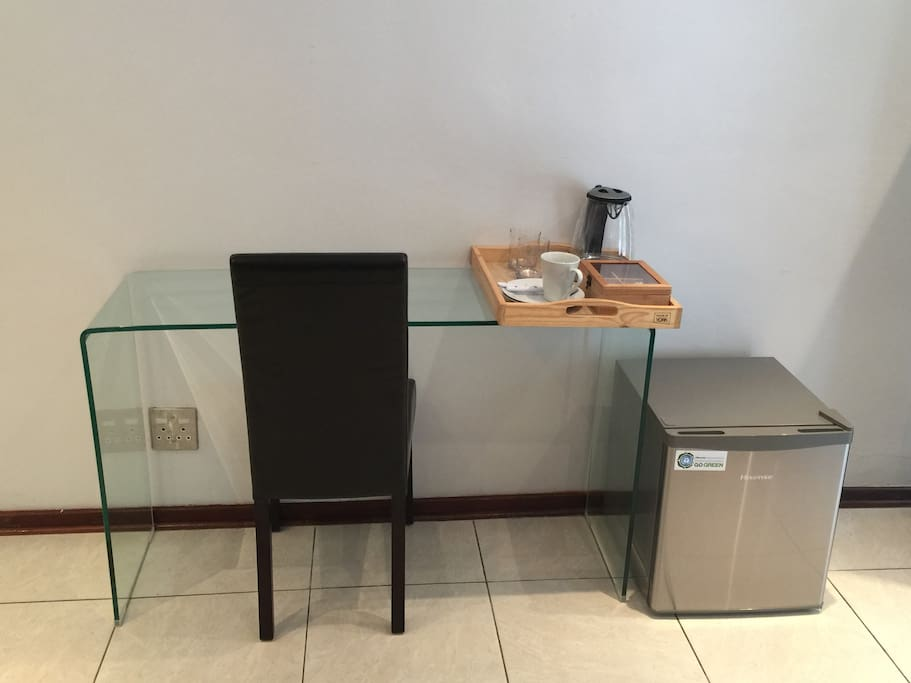Elegant work and coffee station with a stocked mini  bar fridge!