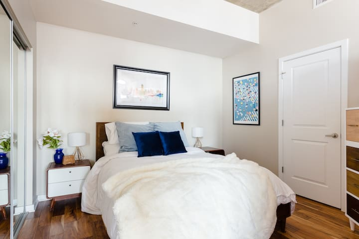 Our restful bedroom with queen-size bed, 100% cotton 600 thread count sheets, Canada Goose comforter and super comfy memory foam pillow-top mattress