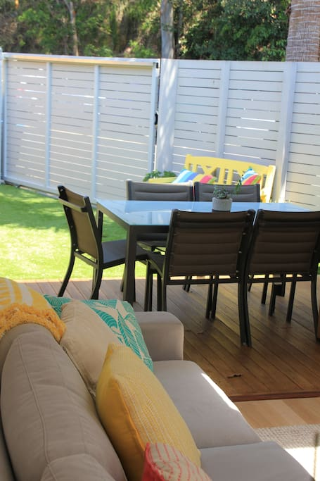 The open plan living area opens up into a sunlit back garden