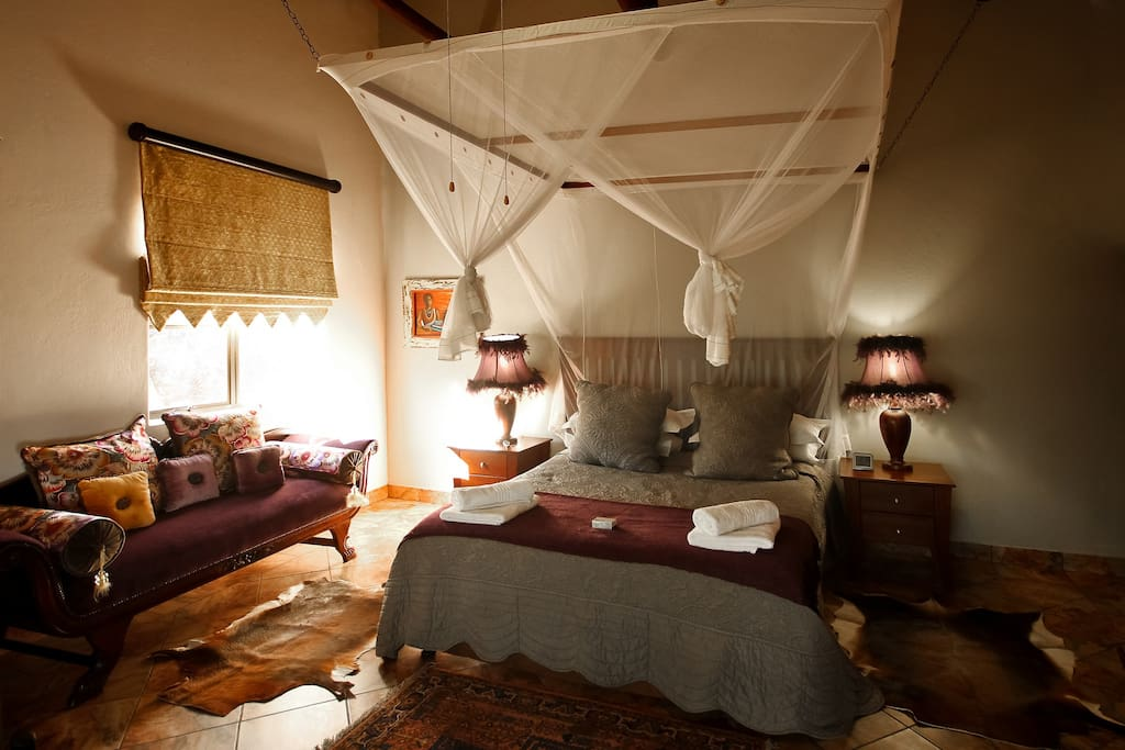 Main Bedroom: - En-suite, with an extra length Queen sized Bed. - Double size sleeper couch - Verandah in front of the room overlooking the Swimming Pool & Waterhole.