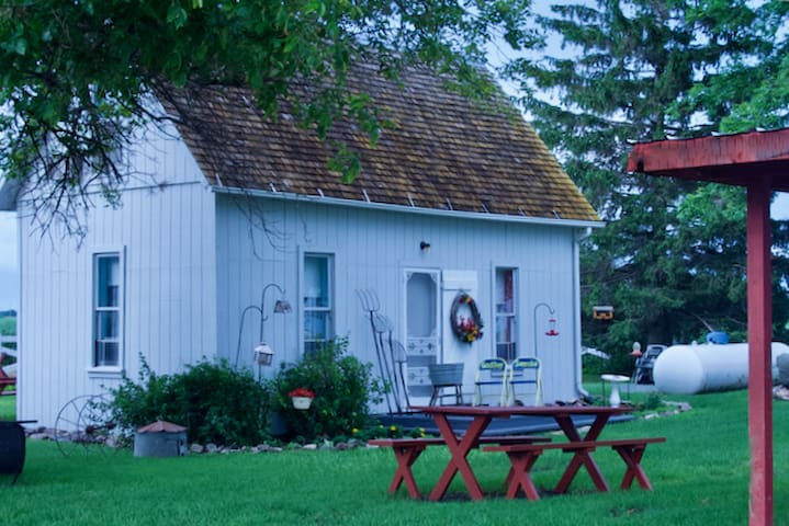 Rustic, restored original home on a century farm.