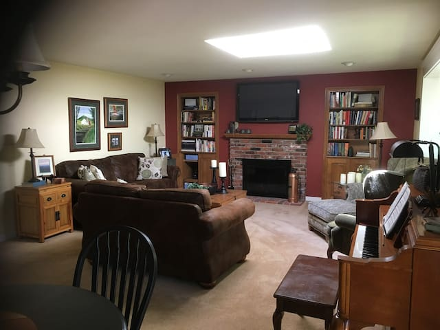 """Living Room.  Gas Fireplace.  50"""" television."""