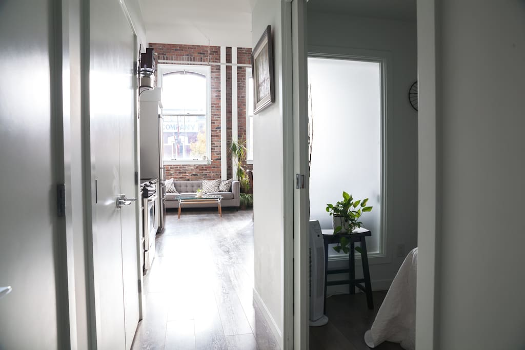 Front entrance hallway; ensuite bedroom on the right and three storage closets.