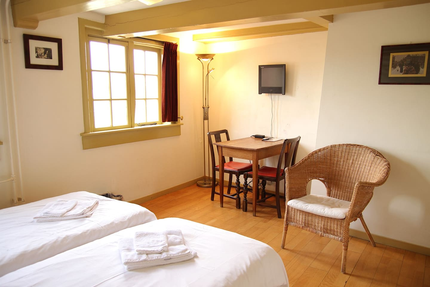 The room has three comfy single beds.