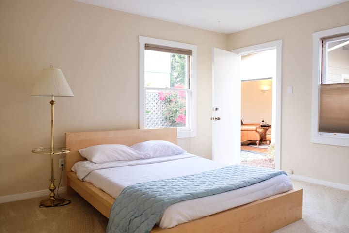 Master bedroom with access to courtyard and Seashell Bungalow.