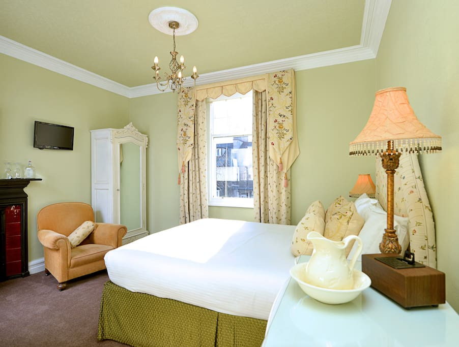 The king size bed in a light and airy room