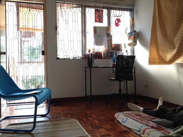Bedroom door, window, desk & base of sleeping mattress
