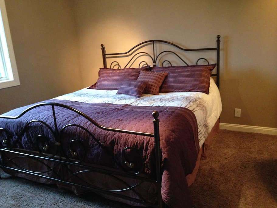 Extra large airy bedroom with king size bed and walk in closet.  Enjoys a sink/vanity in bedroom with private entrance to shared bathroom.
