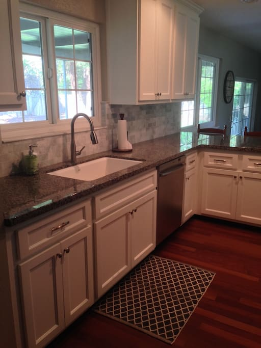 Brand New Kitchen with granite countertops and stainless steel appliances