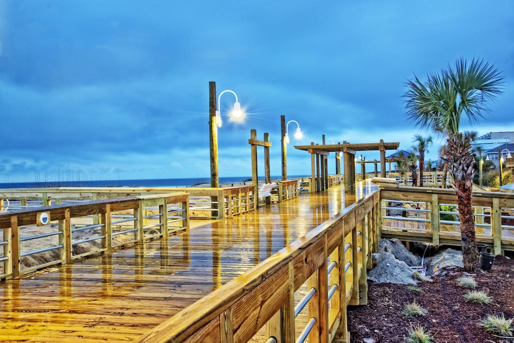 Enjoy a stroll on Carolina Beach's newly built boardwalk! Porch swings and benches are available for optimum view of the ocean. Located only a quick five minute stroll from The Beach House.