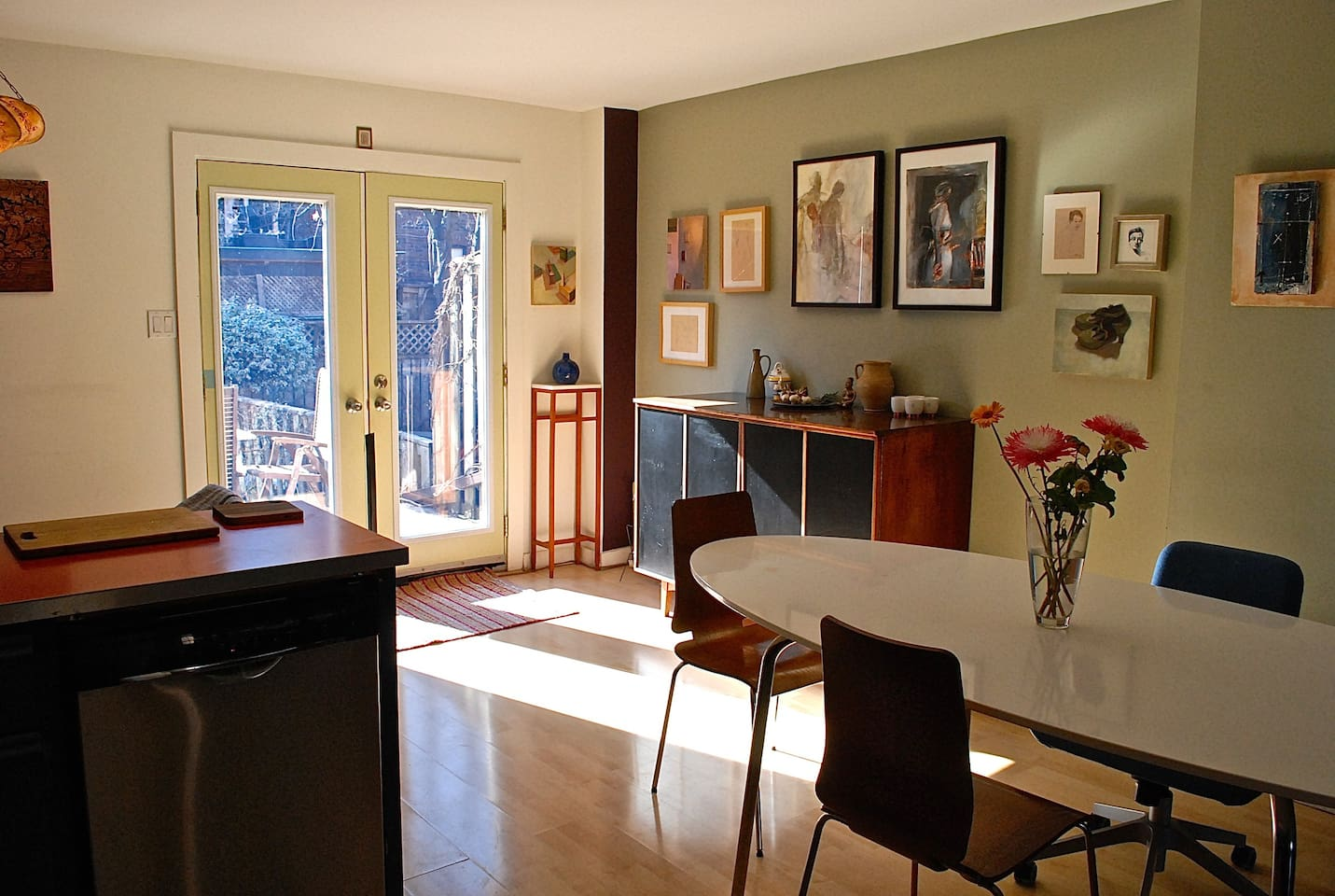Kitchen table and French doors leading to deck and garden