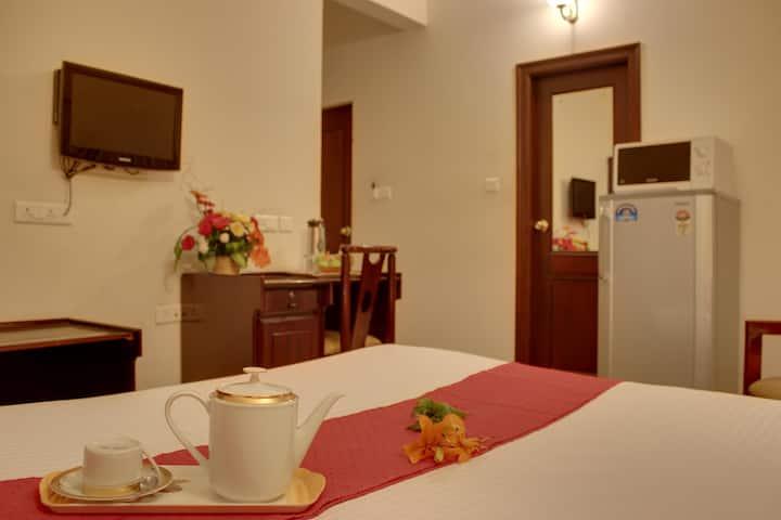 Deluxe room with a spacious balcony in Indiranagar