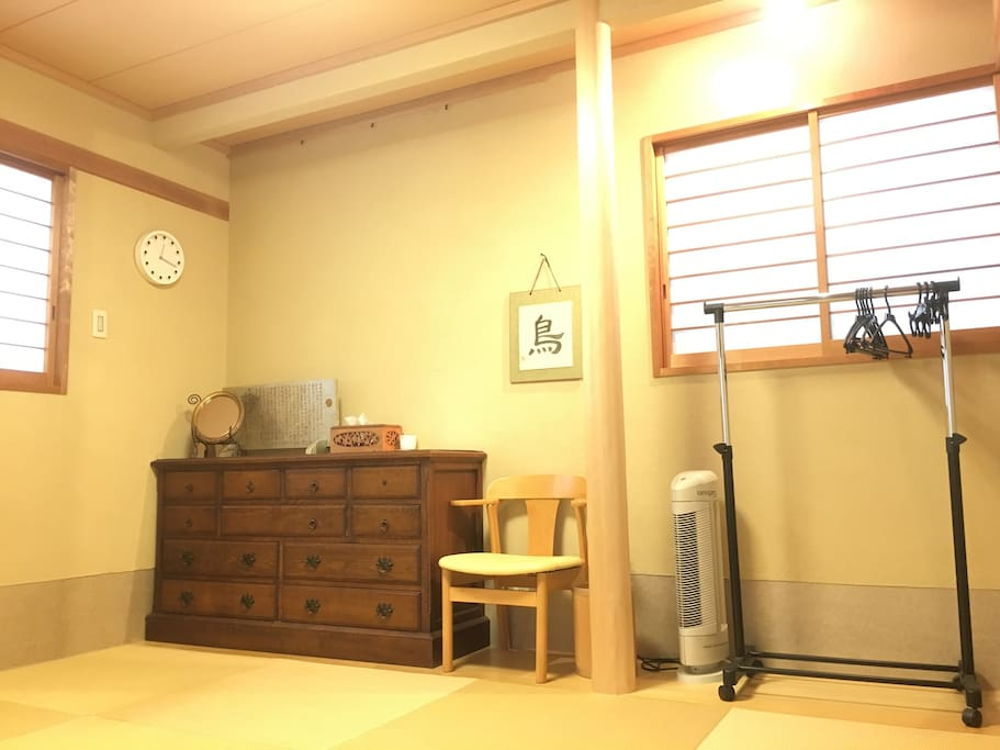 guest room. There are a mirror, hangers, a chair, an air purifier.