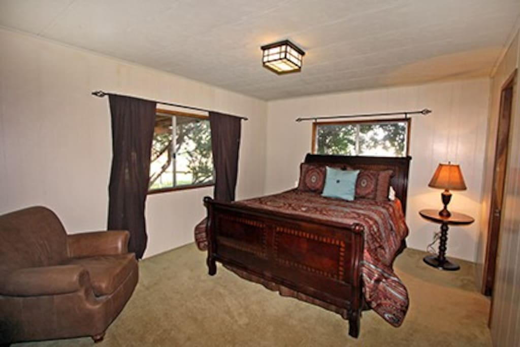 Master Bedroom with Queen bed and private master bath with shower & tub