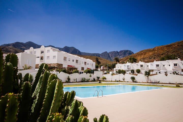 Maravillo apartamento con piscina y WiFi