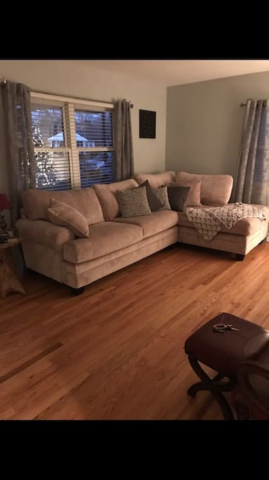 Living room is complete with comfortable chaise sectional, leather recliner and ottoman, and leather chair with ottoman. Snuggle up with fuzzy blankets and relax!