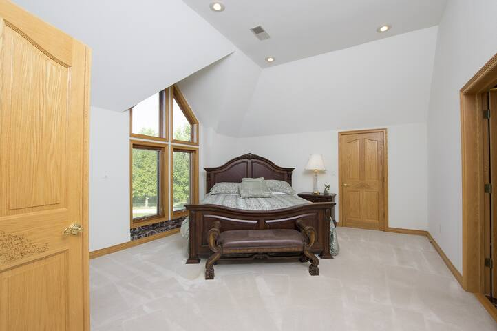Bedroom with king bed and private bath