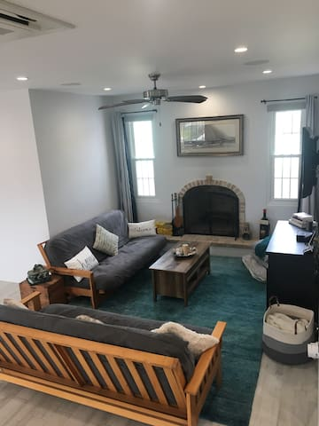 Livingroom space is versatile and has a working Fireplace