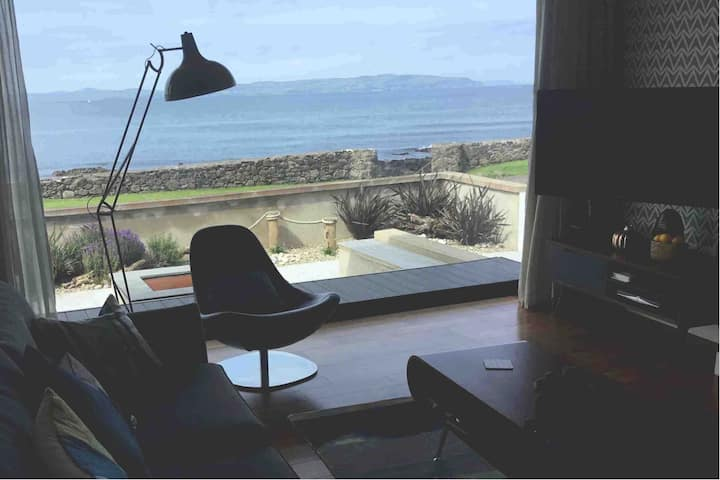 Shore, situated on coast, just metres from the sea