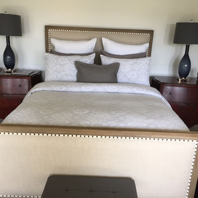 Romantic queen size bed with luxury linens.