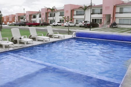 Sofa bed in a common area. - Juriquilla
