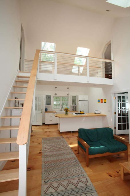 Open stairs and catwalk joining two upstairs bedrooms