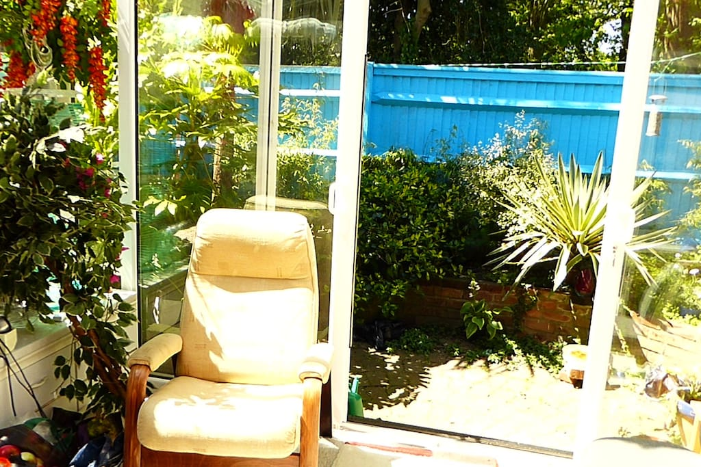 relax in the sunny conservatory and watch the birds and squirrels at play