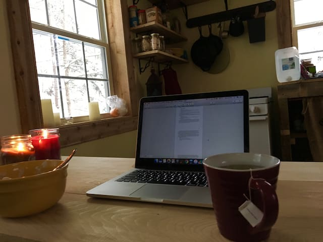 The perfect way to spend a snowy morning: writing by the fire with tea.