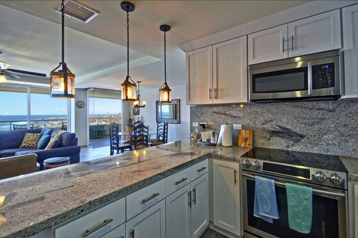 Full equipped kitchen and bar with stainless steel appliances