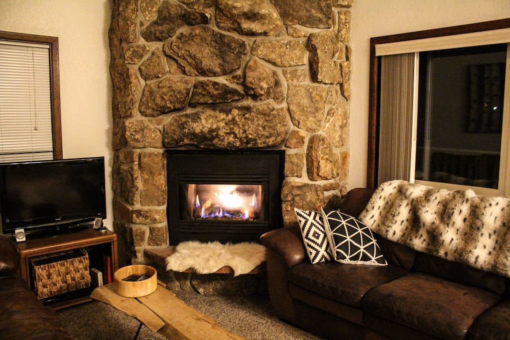 Remote controlled gas fireplace and cozy leather couches.
