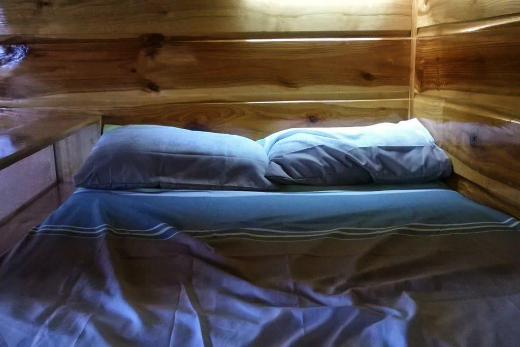 Perhaps you'd sleep better all snug against a wall?