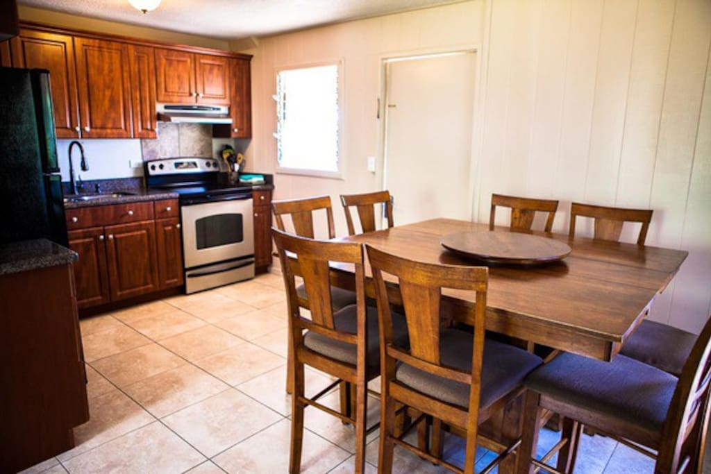 Full kitchen with dining table good for 8 guests.