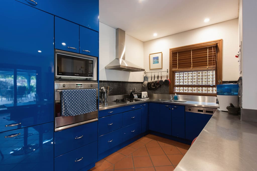 Well appointed, easy kitchen with modern appliances including Smeg oven and stove top, Nespresso machine, microwave.