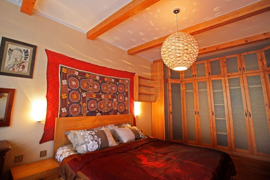The master bedroom, with a large, comfy bed, brilliantly laid out decoration and large wardrobe.