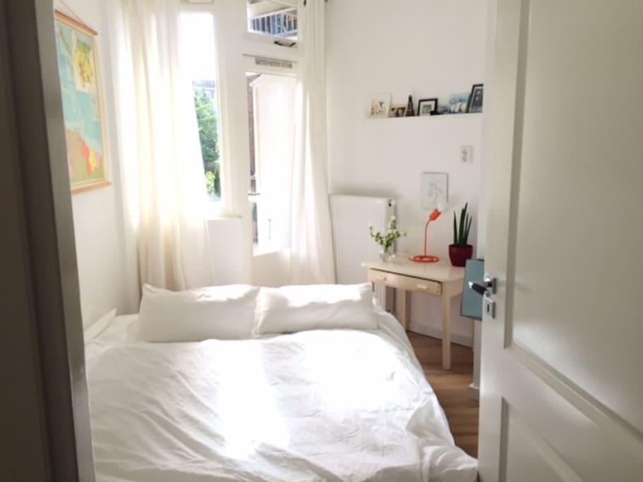 Cozy, light bedroom, with door to the balcony
