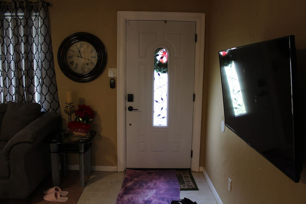 This is the front door that you open to get inside the house.
