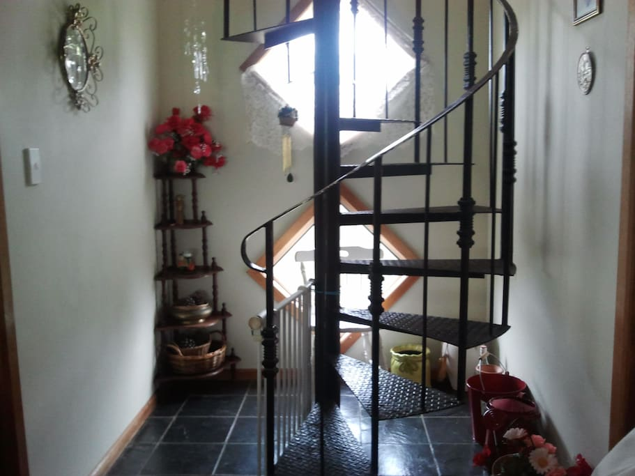 Spiral staircase to upstairs bedroom and reading nook