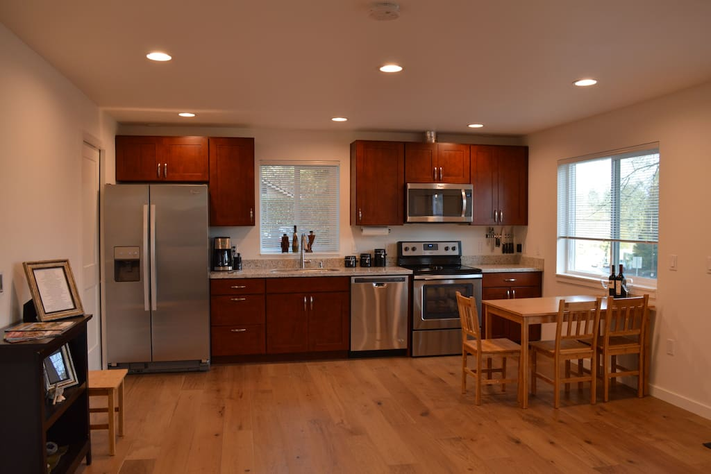 Kitchen with brand new stainless steel appliances and granite countertops