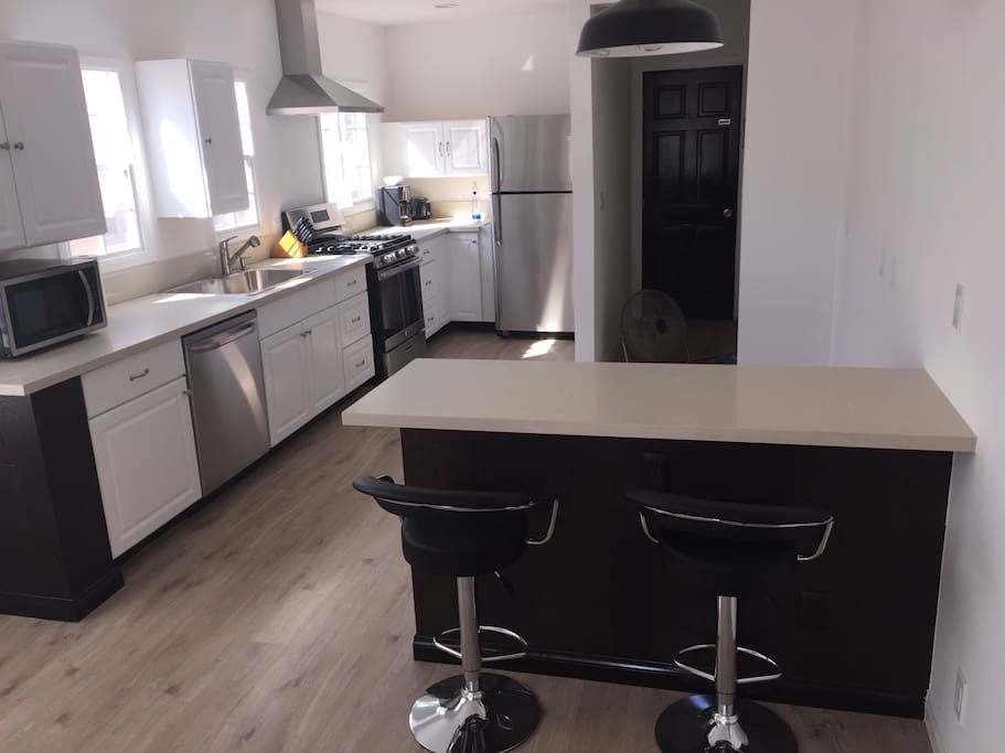 Large open kitchen and island with bar stools