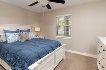 Spacious bedroom with comfortable king size bed and flat screen TV with full cable.  Private bathroom and walk-in closet is attached to bedroom.