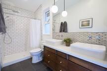 Newly renovated master bathroom with rainshower