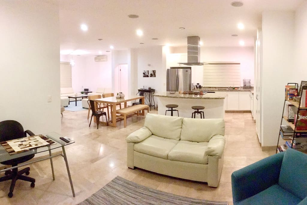 Open space concept: living room, dining room, TV room and kitchen