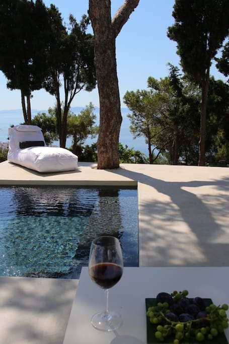 The pool level- lounging on the couch, drinking wine, enjoying the view.