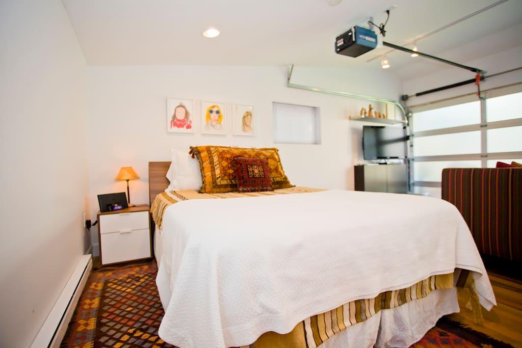 Comfy bed and original art work.