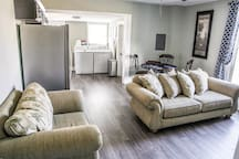 Open floor plan with washer/dryer and free laundry detergent/dryer sheets. Also kitchen is fully stocked along with coffee machine and free coffee/cream.