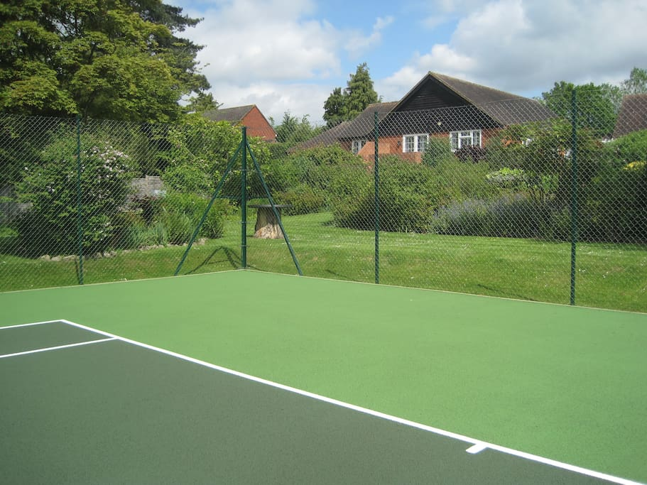 View from newly renovated tennis court towards Lavender Cottage