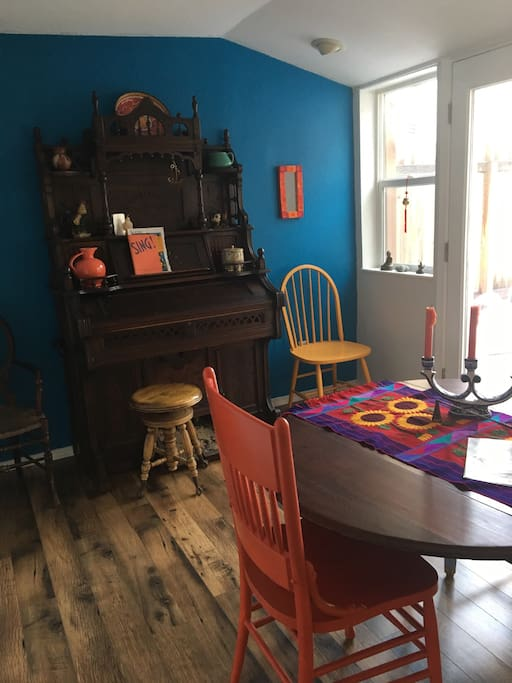 Dining room with antique foot pump organ