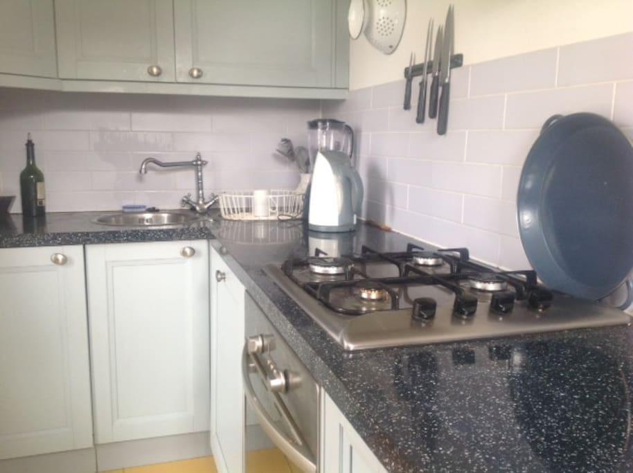 Separate modern kitchen with washing machine