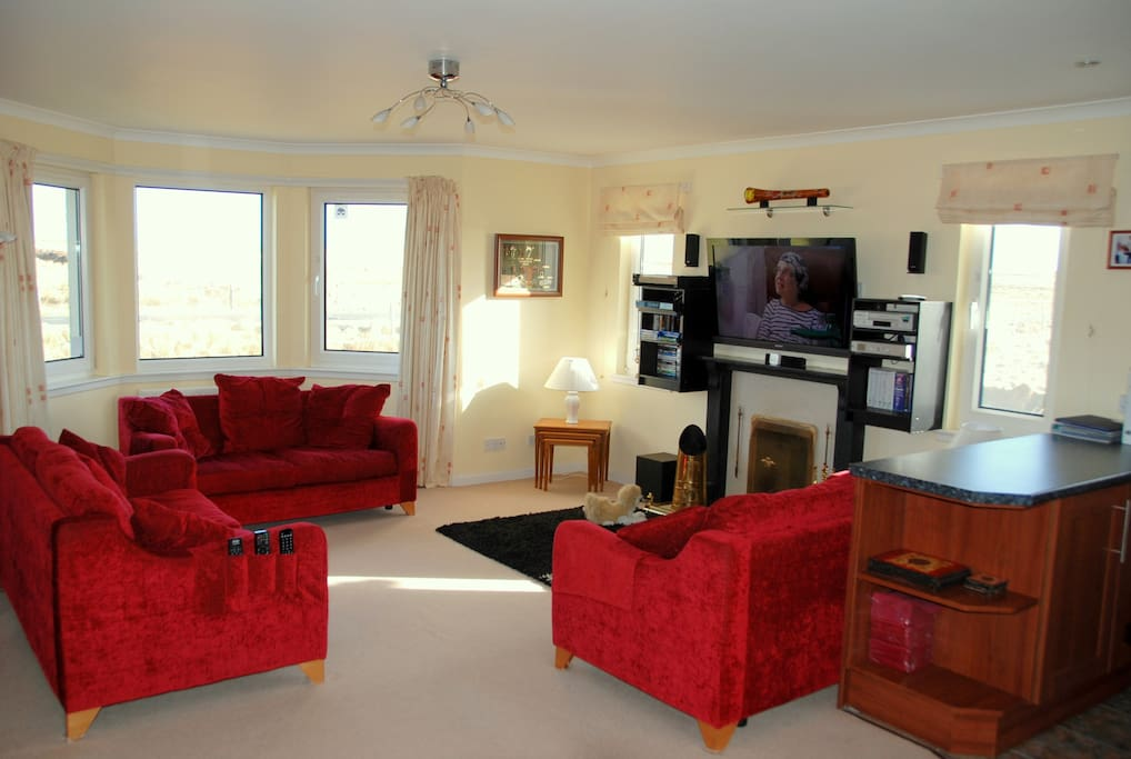 Comfortable living room with TV, DVD, selection DVD's, books, board games etc
